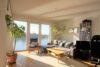 CITYHOUSE: Exklusiver Rheinblick, oberste Etage, Komfortwohnung mit Balkon, Aufzug, 2 TG Stellplätze - Gemütliche Sitzecke mit Aussicht